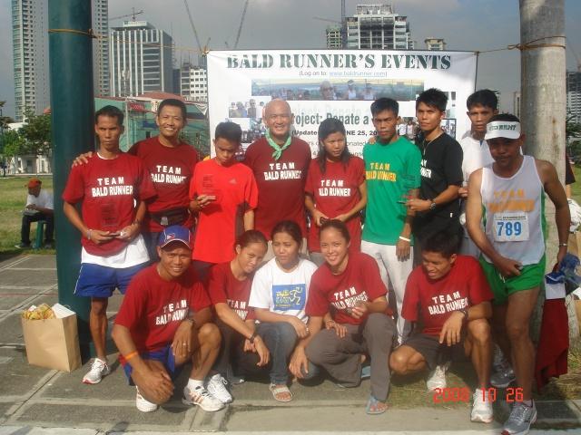 """Members of """"Team Bald Runner"""""""