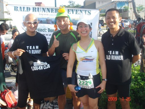Mark Parco aka Mark's VO2 With Tiffin Receiving The Finisher's T-Shirt