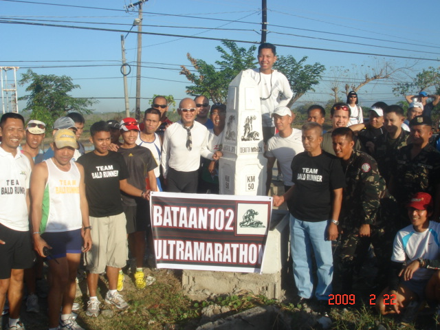 Another Group Picture With The Bataan 102 Logo