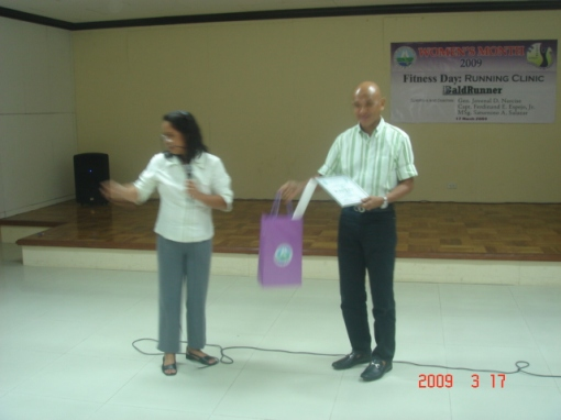 Receiving a Certificate Of Appreciation & Loot Bag