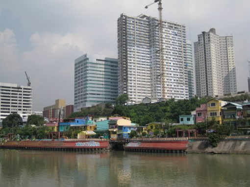 What is the difference living in a Gawad Kalinga Community and in a High-Rise Condo along the Pasig River?