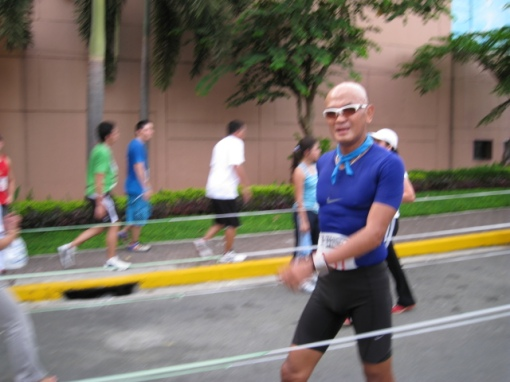 The Smiling Bald Runner