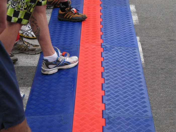 Look At The Disposable D-Tag From ChronoTrack Timing System Tied On The Shoes Of Each Runner