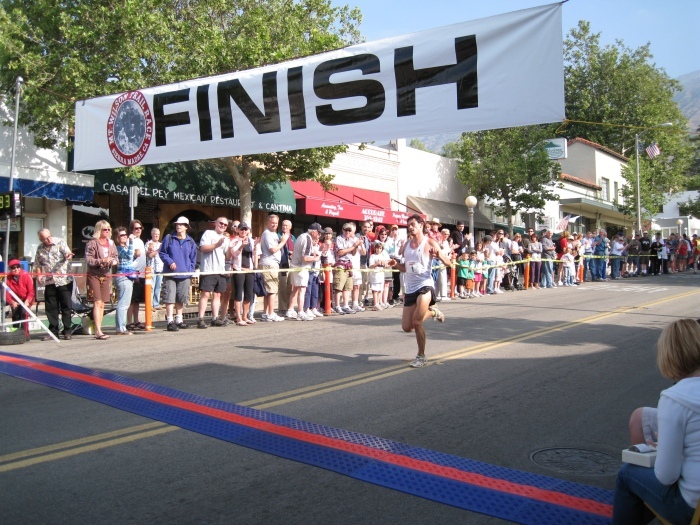 Arrival of the 1st Runner to Reach The Finish Line