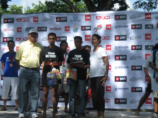 Cris & Rey of Team Bald Runner as Champions in the 100K Relay Race