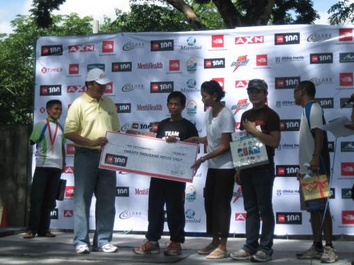 Ed Villanueva Receiving The Check Worth P 20,000