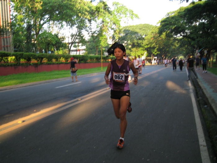 Marecil Maquilan Winning The 5-Mile Run, Women's Category