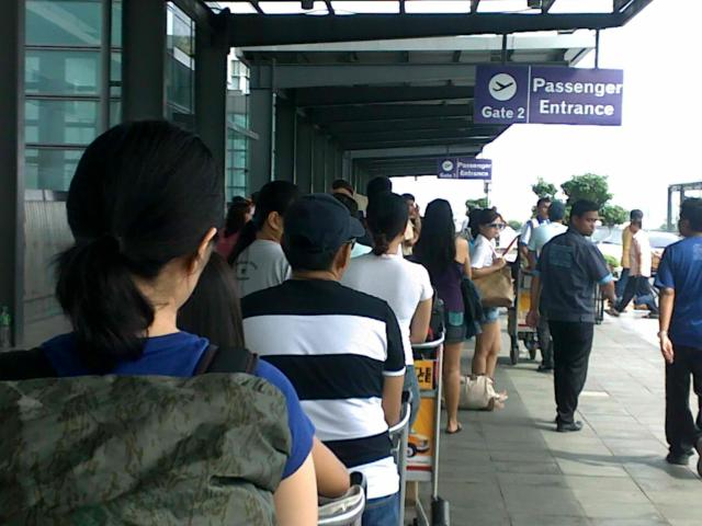 Long Line of Passengers Before The Entrance of the terminal