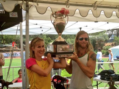 Timothy Olson & Pam Smith With The WS100 Championship Cougar Trophy (Photo Courtesy of IRunFar.com)