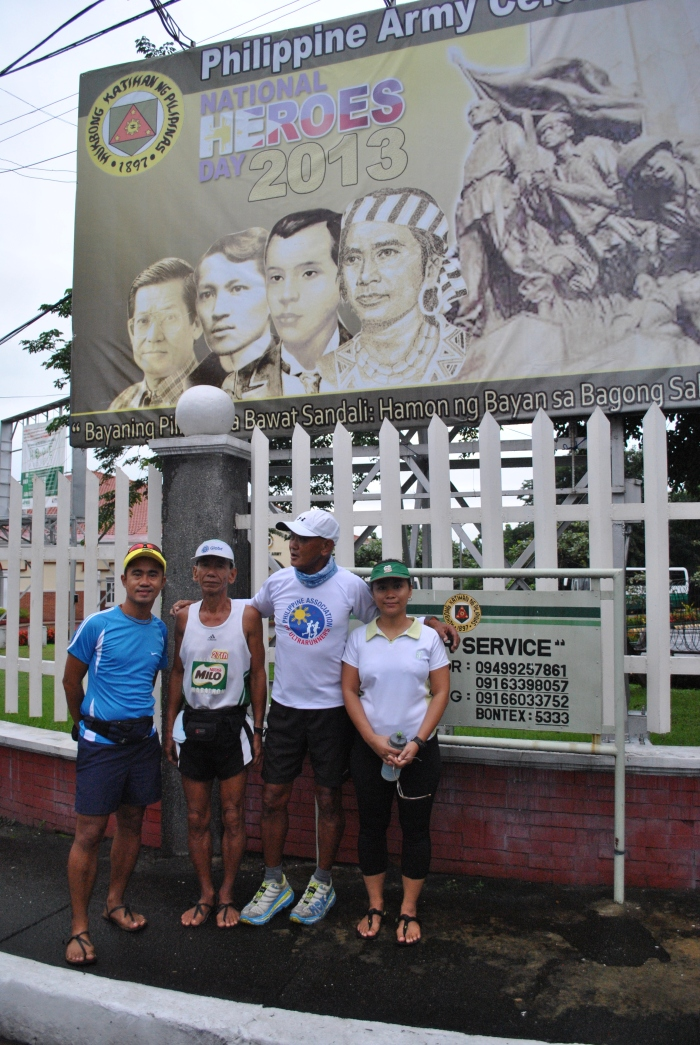 Posing In Front Of The Philippine Army Tarp