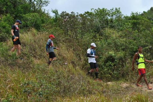 "Three Runners With Guide Arriving @ ""Binutas"""