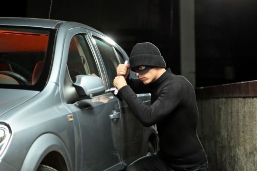 A Thief Trying To Open A Locked Car (Picture From Google)