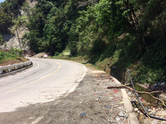 Free-Flowing Water on the Right Side of the Road Near a Landslide Repair/Construction