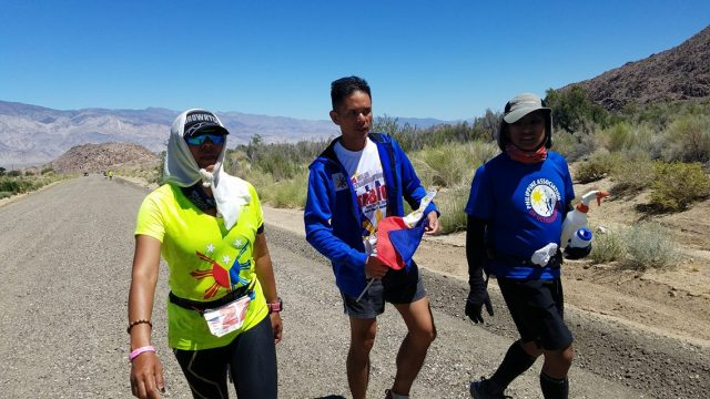 Gerald Tabios Cheering & Handing The Philippine Flag 10 Miles To The Finish Line